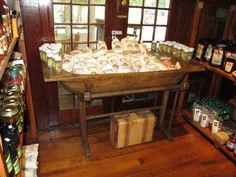 Our antique dough bowl on stand is used as a  country store display