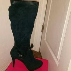 Emerald Green Boots Emerald green boots, with leather trim , worn twice Shoe Dazzle Shoes Heeled Boots