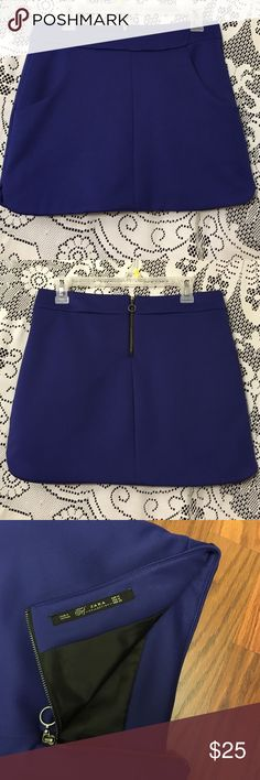 "NEW! ZARA Purple Scuba Mini Skirt Never Worn! Elegant and Beautiful purple mini skirt, 2 side pockets, back zipper, 1 1/2"" slit on each side, Scuba Material which is a double lined knit fabric of fine polyester fibers that is super smooth, Size Medium Zara Skirts Mini"