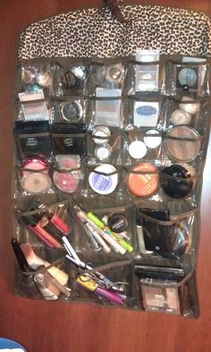 Makeup organizer - from jewelry pouch hanger....might try this hanging inside a cabinet door. Better to see everything and not have to dig??