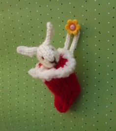 Bunny in a stocking : Here is another knitting project for you. The bunny does not have limbs so it is easy. Bunny in a stocking Size: Difficulty level: beginner Materials Miniature Christmas, Christmas Toys, Xmas, Christmas Projects, Christmas Ideas, Christmas Things, Christmas Ornaments, Christmas Stocking, Holiday Crafts