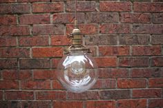 "Industrial Pendant Light Clear Glass Globe 6"" Round Antique Brass Plug In or Canopy Kit by IlluminateVintage on Etsy"