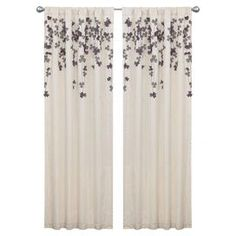 """Curtain panel with cascading flower motif in ivory and purple.  Product: Curtain panelConstruction Material: 100% PolyesterColor: Ivory and purpleFeatures: Rod pocket slides onto curtain rod for installationDimensions: 84"""" H x 42"""" WNote: Curtain rod not included. Cleaning and Care: Dry clean only"""