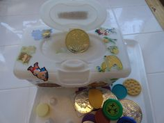 Container turned treasure chest. Good fine motor, opening, closing, using button, adding treasure. Tip: encourage crossing midline by setting trays and baskets apart from eachother