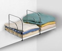 10 Ways to Squeeze a Little Extra Storage Out of a Small Closet - Store clothes on shelves more efficiently with shelf dividers. Small Closet Organization, Closet Shelves, Organization Ideas, Clothes Storage Ideas For Small Spaces, Clothes Storage Ideas Without A Closet, Closet Ideas, Small Closet Storage, Clothing Organization, Clothing Storage