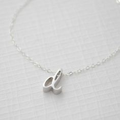 Cursive Lowercase Letter Necklace by Olive Yew. his whimsical cursive font is exclusive to Olive Yew - you won't find it anywhere else. Get it in Silver, Gold, Rose Gold.