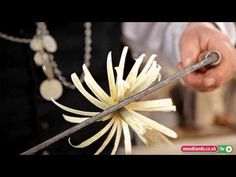 Ian Barnett demonstrates how to make wooden gypsy flowers using a draw knife and coppiced hazel. He shows the different effects achieved by using green wood . Wood Carving Designs, Carving Wood, Wood Carvings, Wood Flowers, Wood Spoon, Whittling, Sculpture, Wood Turning, Wooden Toys