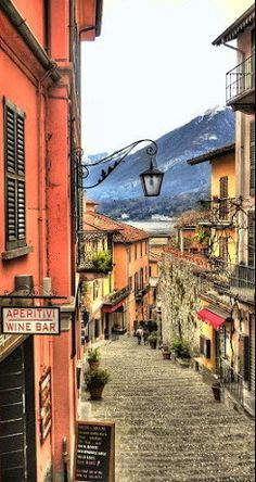 Enchanting Bellagio ~ some call the prettiest town in Europe is located on Lake Como in Italy.  At dusk, an orchestra serenades dancers under the stars at the wharf.