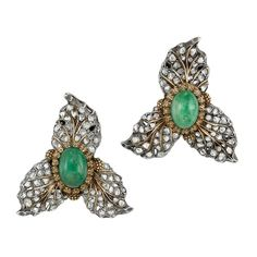 Pair of Silver, Gold, Cabochon Emerald and Diamond Earclips, Buccellati  Centering 2 oval cabochon emeralds framed by small finely textured gold leaves, surrounded by curled silver petals set with rose-cut diamonds, accented by gold veins, signed Buccellati, Italy.