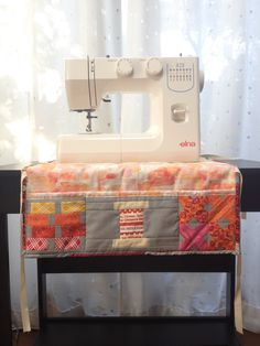 Sewing machine cover that converts to a mat, with little pockets to stash your scissors etc while you sew. Um, genius? Yes.