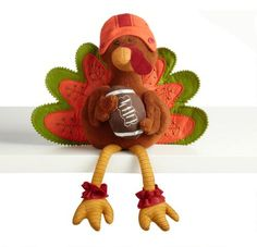 One of my favorite discoveries at ChristmasTreeShops.com: Football Fabric Turkey Sitter