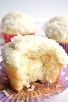 Coconut Cupcakes.  A moist white coconut cake with a creamy coconut filling and coconut frosting on top!