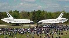 In this photo provided by the Smithsonian Institution via NASA, space shuttles Enterprise, left, and Discovery meet nose-to-nose at the beginning of a transfer ceremony at the Smithsonian's Steven F. Udvar-Hazy Center.  (AP Photo/Smithsonian Institution via NASA, Carolyn Russo))