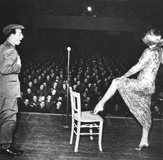 Marlene Dietrich, with comedian Freddie Lightner, during a USO show for U.S. servicemen, 1945 - Photo: George Silk/The LIFE Picture Collection/Getty Images