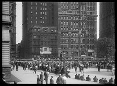 Crowd Watching Baseball Scores Being Posted On The Sun Building, New York City…