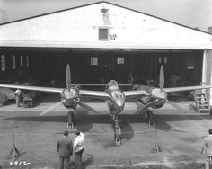 An early P-38 all polished up outside its hanger, California (Date unknown)