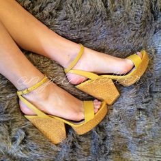 "Yellow wedges ankle straps These aren't your normal wedges, they have a separated heel covered in a straw-like material.  Ankle straps. Length: 10.75, width: 3.5"", heel height: 5"". Some of the ""straw"" is coming undone, see picture. Normal wear Xhilaration Shoes Wedges"