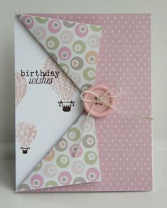 dbl sided fold top sheet folded back and adhered to card front stamped with hot air balloons