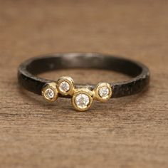 yasuko azuma.  love oxidized silver with gold and diamonds.