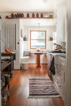 Portland home - breakfast nook, apron front sink, white and wood, vintage accessories, lots of light