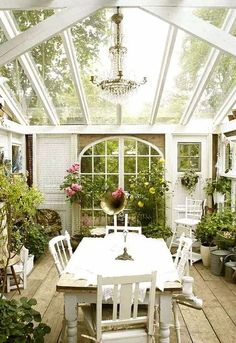 Cottage Porch with Screened porch, Arched window, Natural light, Skylight, Greenhouse, Pathway, Chandelier, French doors