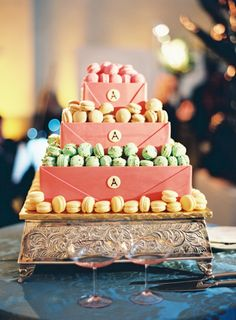 "gorgeous tiered ""cake"" display of macarons // photo by JenHuangPhotography.com"