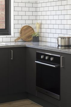 This kitchen features grey spice doors and sour cream doors with enoki benchtops and subway tile splashback Kitchen Reno, Kitchen Cabinets, Bbq Area, Splashback, Subway Tile, Apartment Living, New Homes, House Design, Interior