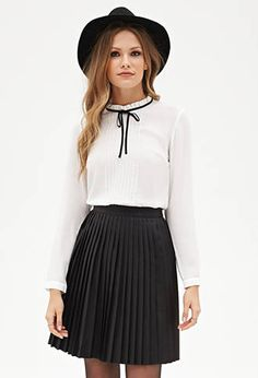 Faux leather pleated skirt and pleated bow-front blouse from Forever21.