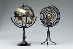A pair of Ptolemaic iron armillary spheres (Christie's)