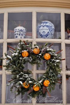 Blue an White Christmas-Sign of the Rhinoceros decorated for Christmas. Century scene at historic Colonial Williamsburg, Williamsburg, Virginia. Christmas Door, Primitive Christmas, Country Christmas, Winter Christmas, All Things Christmas, Christmas Holidays, Christmas Crafts, Christmas Decorations, Xmas