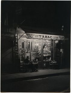 Brassaï, Paris de Nuit:Tabac (1935).  George Brassaï was a Hungarian photographer, sculptor, and filmmaker who rose to international fame in France in the 20th century. He was one of the numerous Hungarian artists who flourished in Paris beginning between the World Wars. [Wikipedia]
