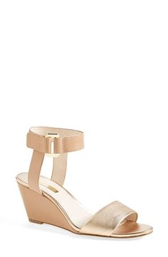 Free shipping and returns on Louise et Cie 'Phiona' Leather Ankle Strap Wedge Sandal (Women) at Nordstrom.com. Bold, sleek straps create a mod aesthetic atop a streamlined sandal lifted by a slim wrapped wedge.