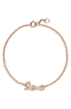 Broadcast limitless love with a sparkling, script-style setting at the center of a darling precious-metal bracelet that would look fabulous layered or worn alone.