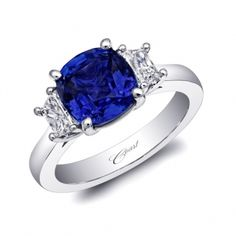A gorgeous ring featuring a 4.04CT cushion cut sapphire, accented by two trapezoid diamonds. Set in platinum. Spectacular designs featuring one-of-a-kind colored gemstones personally selected by owner and designer.