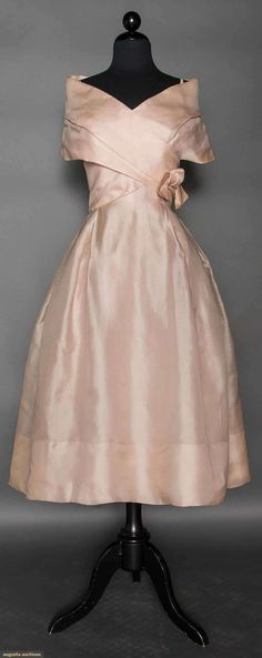 """DIOR COUTURE EVENING DRESS, S/S 1957 Pale pink blush silk, full skirt, sleeveless, spaghetti straps under wide off the shoulder collar, CB bow, self fabric bodice lining, fitted cotton net corset, 3 attached pink crinolines, label """"Printemps-Ete 1957 Christian Dior Paris 35639"""" (ball gown version of identical dress advertised in 1957 L'Officiel Magazine)"""