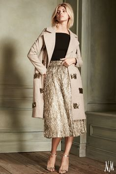 Redefine fall fashion with a metallic fringe coat by Lela Rose. Couple with a shimmering skirt for an ultrachic cool-weather ensemble.