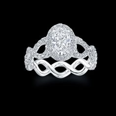 Norman Silverman braided diamond ring. 1.1ct aproximately $12,995.00 (retailed at Bailey Banks & Biddle)