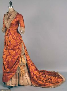 2 Piece Purple And Orange Bustle Gown Made Of Silk Brocade With Purple And Orange Flowers And Foliage   c. 1878-1883