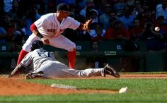 *** BESTPIX *** BOSTON, MA - SEPTEMBER 27: Jose Pirela #67 of the New York Yankees slides into third base as Garin Cecchini #70 of the Boston Red Sox tries to make the play during a game at Fenway Park on September 27, 2014 in Boston, Massachusetts. (Photo by Elsa/Getty Images)