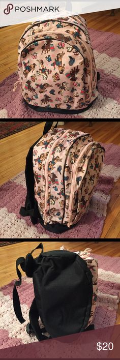 Horse backpack-adorable! This is perfect for a little girl who loves horses. It is very thick canvas, waterproof, and fits a lot for your little one. Adjustable shoulder straps perfect for when she wants YOU to carry it! Front section and back section, separate zippers. Pulls on the zippers for ease of use. Black canvas bottom keeps it looking good! In great used condition.Measures 15 in. x 12 in. x 7 in.  Extra-durable 600-denier polyester fabric Interior moisture-resistant nylon Interior…