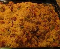Liberian Jollof Rice is baked rice with tomatoes, chicken, beef, and shrimp