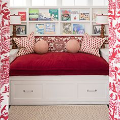 """Embellish Lampshades    """"Put grosgrain ribbon around the top and bottom of a lampshade,"""" says designer Ann Wolf, who decorated this reading nook in a Houston home with matching lampshades trimmed in red. """"You just glue it on – use clothespins to hold it in place as you go around,"""" she says."""