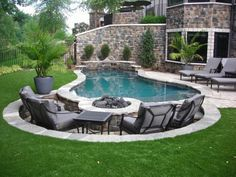 Fire pit near the pool. Love this idea!