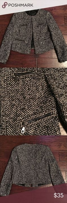 ZARA TWEED MOTO JACKET Zara white and black tweed moto-style jacket - size large. Can very easily dressed up or down! Overall good condition, but there is some pilling due and the material is naturally fuzzy. Jacket has 4 zipper pockets and zippers at the cuffs. Zara Jackets & Coats