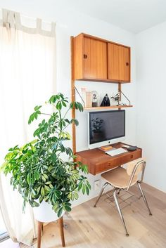 Our Mid-Century planter spotted in this vintage modern home in Berkeley. Seen on Apartment Therapy.