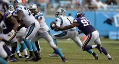 Minnesota Vikings defensive end Everson Griffen (97) closes in on Carolina Panthers quarterback Cam Newton (1) in the second half at Bank of America Stadium on Sunday, September 25, 2016. The Vikings won, 22-10.