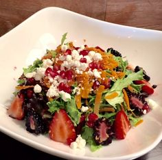 A loaded fruit detox salad! Mesclun Mixed Greens with pomegranate seeds, carrots, blackberries, strawberries, flax seeds & cucumbers topped with goat cheese & our homemade balsamic vinaigrette.