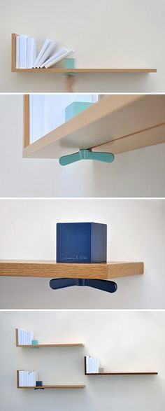 "Hold on Tight bookshelf by ColleenAndEric.com - Even in the digital age, we all still have personal libraries of books we just can't let go of. Use the Hold on Tight bookshelf to keep your most treasured books upright, on display, and close at hand. A brightly-coloured aluminum cube and oversized wing nut serve as a sliding bookend which can be adjusted and secured wherever it is needed, whether your book collection is growing or shrinking. Offered in Beech, Walnut and Oak. (41""L x 11""H x 8""D)."