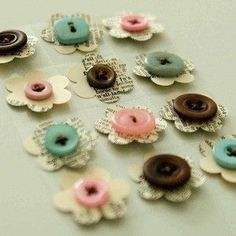 These flowers made from buttons and book pages would look great framed in a grouping. Or glued in clusters of three to the corner of a painted frame.