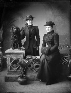 Two circa late Victorian era ladies from Tramore, Co. Waterford, Ireland with a water spaniel ~ & he/she's the only one looking at the photographer... #portraits #Victorian #vintage #women